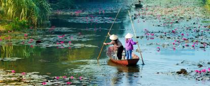Locals kayak through the waters of Hanoi in Vietnam.